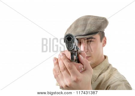Young Man Shooting With A Gun, Vintage Clothes, Isolated On A White Background