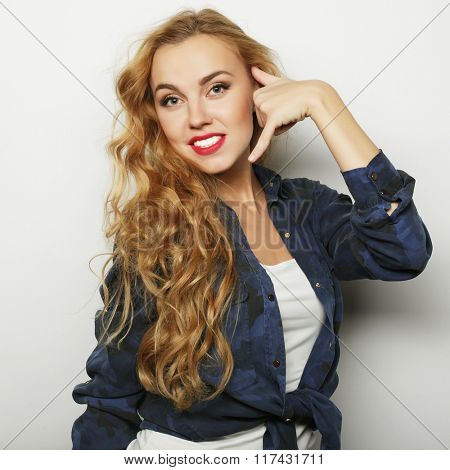 Portrait of a pretty smiling young curly woman