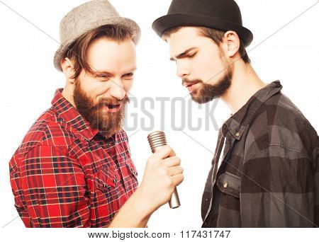 young mens singing with microphone