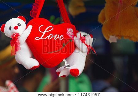 Photo Capturing A Heart Saying Love Held By Two Little Teddy Bears In White And Red