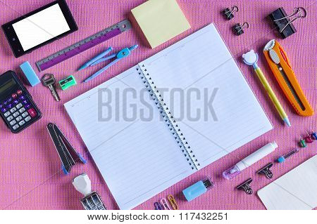 Type Around Note Book Open to Blank Page Arranged on pink fabric