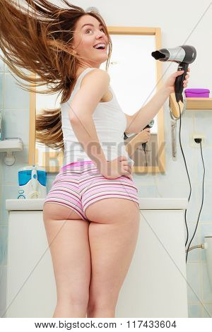 Long Haired Woman Drying Hair In Bathroom Rear View