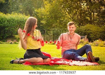 Couple With Hearts Necklace On Picnic