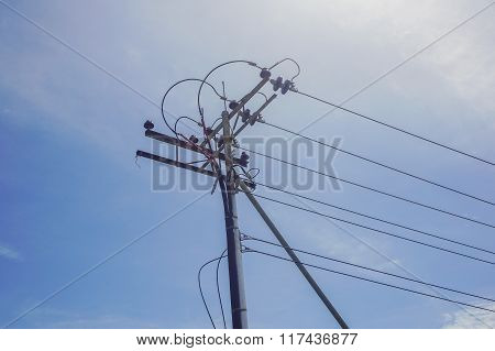 Electrical power lines as sky blue in background
