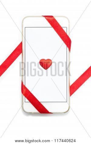 White Cellphone With Red Heart And Ribbon On White