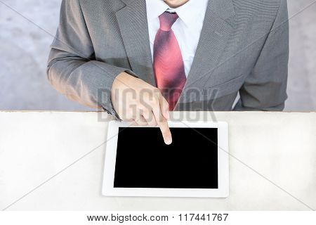 Executive Businessman In Suit Touching And Swiping In Black Blank Empty Tablet - Ready To Put Any Te