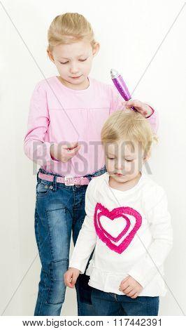 portrait of combing little girls