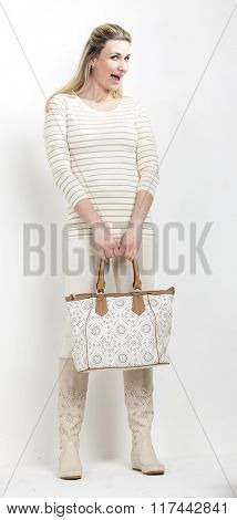 standing woman wearing summer boots with a handbag