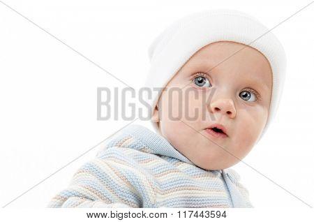 little child baby boy portrait 1 year warm cloth hat isolated on white studio shot
