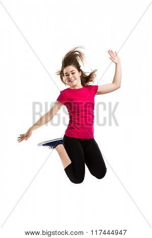 Teenage girl jumping on white background