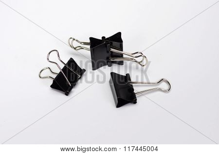 Paper Clips On White Background.