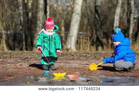 little boy and girl playing in spring