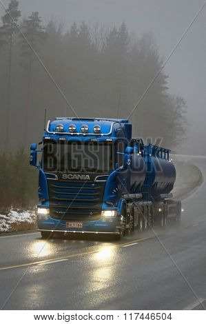 Blue Scania R580 Tank Truck On Foggy Road, Vertical View