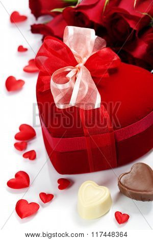 Valentine composition with roses and gift box over white