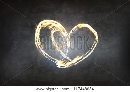Heart symbol created by fire light