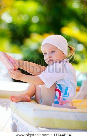 Girl Relaxing Near Swimming Pool