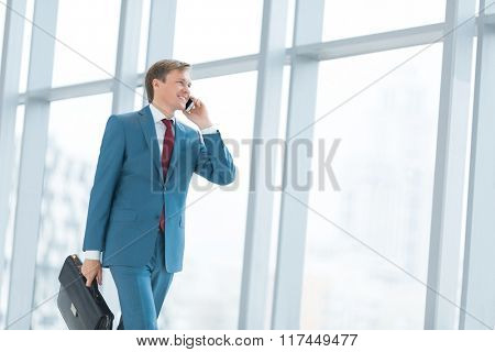 Businessman with phone in office