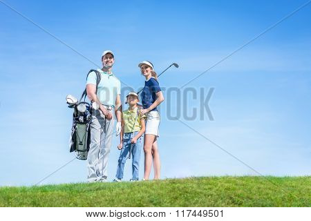 Family with child on a golf course