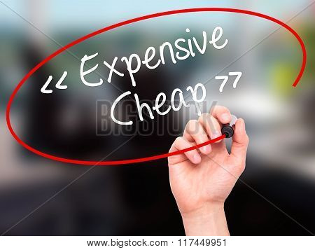 Man Hand Writing Expensive - Cheap With Black Marker On Visual Screen.