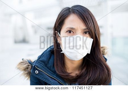Woman wearing medical face mask for protection