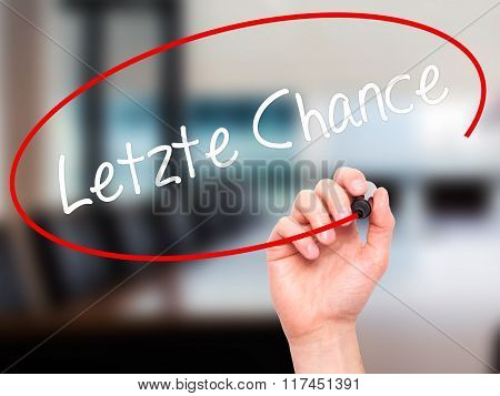Man Hand Writing Letzte Chance  (last Chance In German) With Black Marker On Visual Screen.