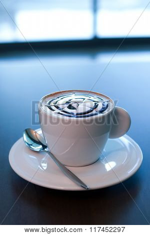 A cup of cappuccino with chocolate