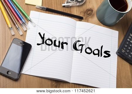 Your Goals - Note Pad With Text On Wooden Table