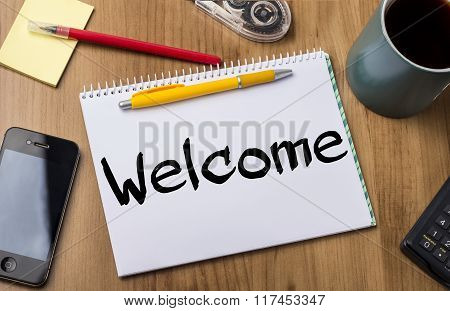 Welcome - Note Pad With Text On Wooden Table