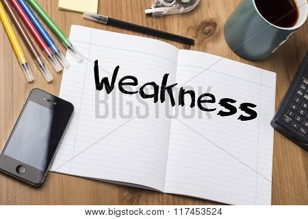 Weakness - Note Pad With Text On Wooden Table