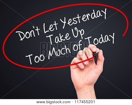 Man Hand Writing Don't Let Yesterday Take Up Too Much Of Today With Black Marker On Visual Screen.