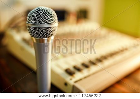 Microphone On Sound Mixer Background. Copy Space For Text.