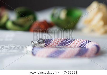 Handmade Crochet Beaded Bracelet On Textile Background