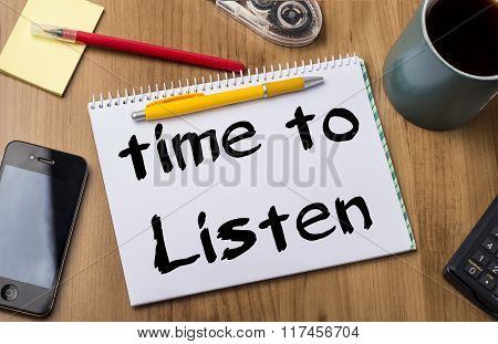 Time To Listen - Note Pad With Text On Wooden Table