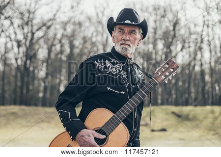Middle Age Male Western Musician At The Woods