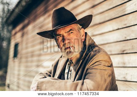 Smoking Elderly Man Looking Afar Seriously