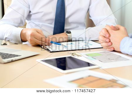 Real-estate Agent Discussing A House Plans With A Businessman.