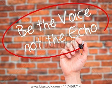 Man Hand Writing Be The Voice Not The Echo With Black Marker On Visual Screen.