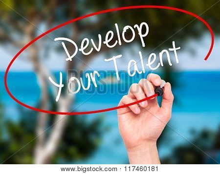 Man Hand Writing Develop Your Talent With Black Marker On Visual Screen.