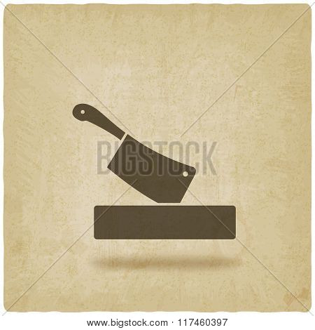 butcher knife in chopping board old background