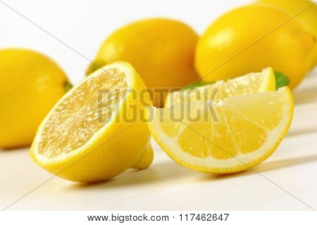 detail of whole and sliced lemons