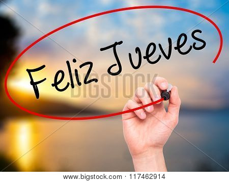 Man Hand Writing Feliz Jueves (happy Thursday In Spanish) With Black Marker On Visual Screen.