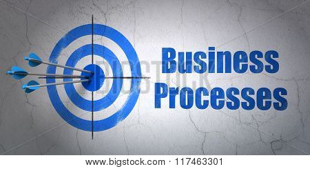 Finance concept: target and Business Processes on wall background