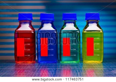 colored liquid in glass bottles