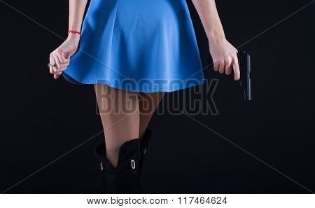 Girl in dress with gun in hand