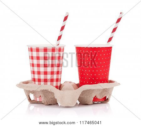 Two paper cups with takeaway drinks in holder. Isolated on white background