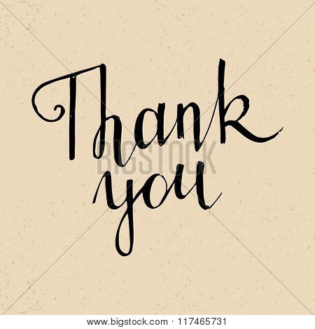 Thank you handwritten lettering on old paper background