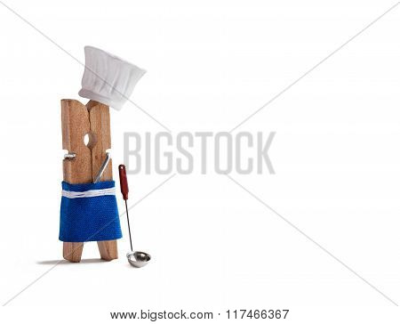Chef cooking with kitchen spoon, soup ladle. Funny clothespin restaurant character dressed in hat, b