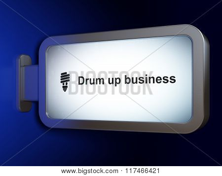Business concept: Drum up business and Energy Saving Lamp on billboard background