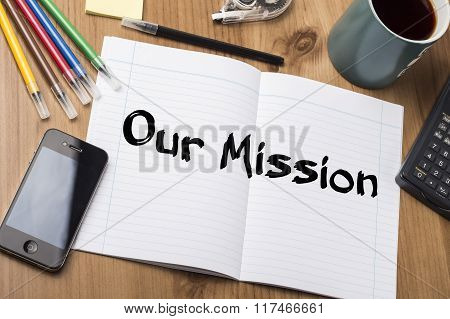 Our Mission - Note Pad With Text On Wooden Table
