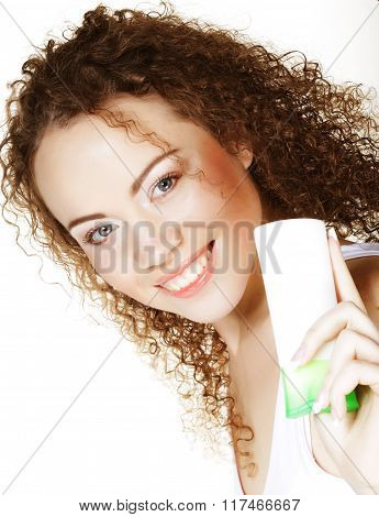 Beautiful spa girl holding jar of cream